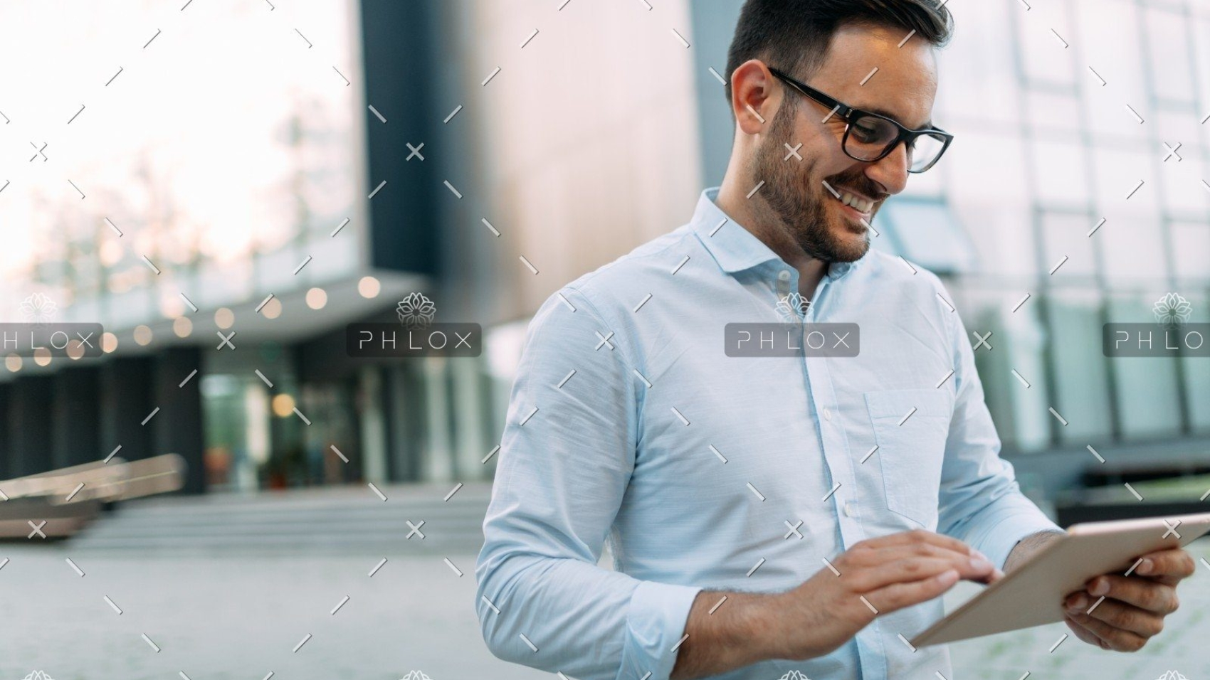 demo-attachment-508-portrait-of-businessman-in-glasses-holding-tablet-AWVHCJU